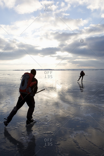 Long-distance ice skaters on shiny ice
