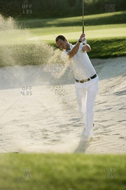 A Scandinavian man playing golf in Italy