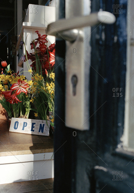 An open door leading to a flower shop in Amsterdam