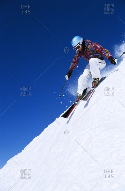 A woman skiing downhill in Jamtland, Sweden