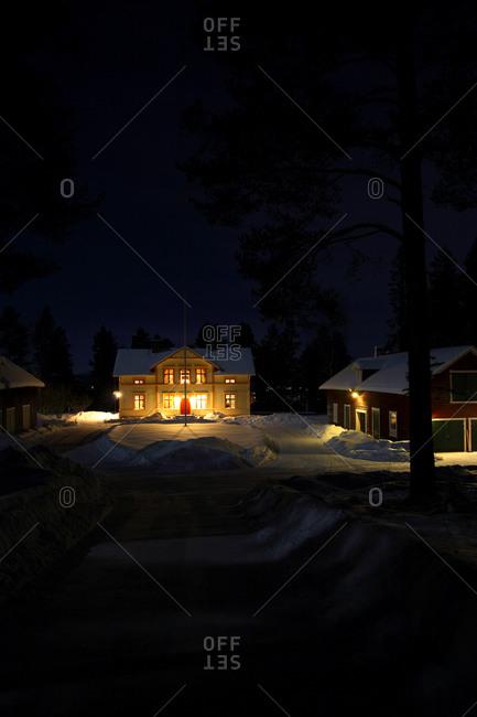 An illuminated house at night, Norrbotten, Sweden