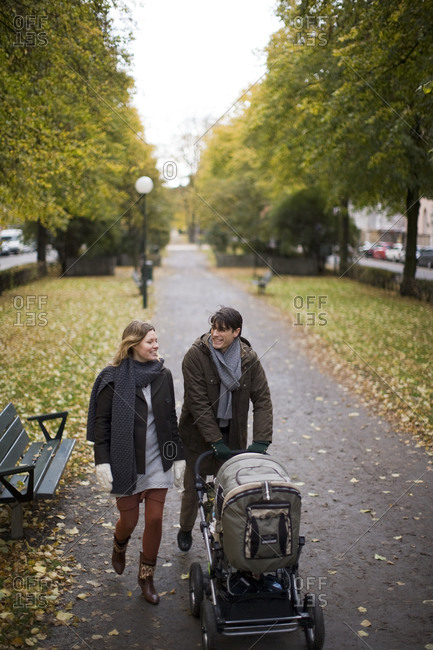 A couple taking a walk with their baby, Sweden