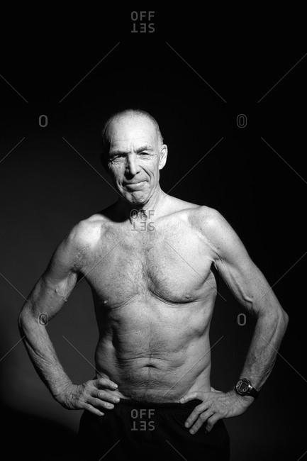 A mature shirtless man