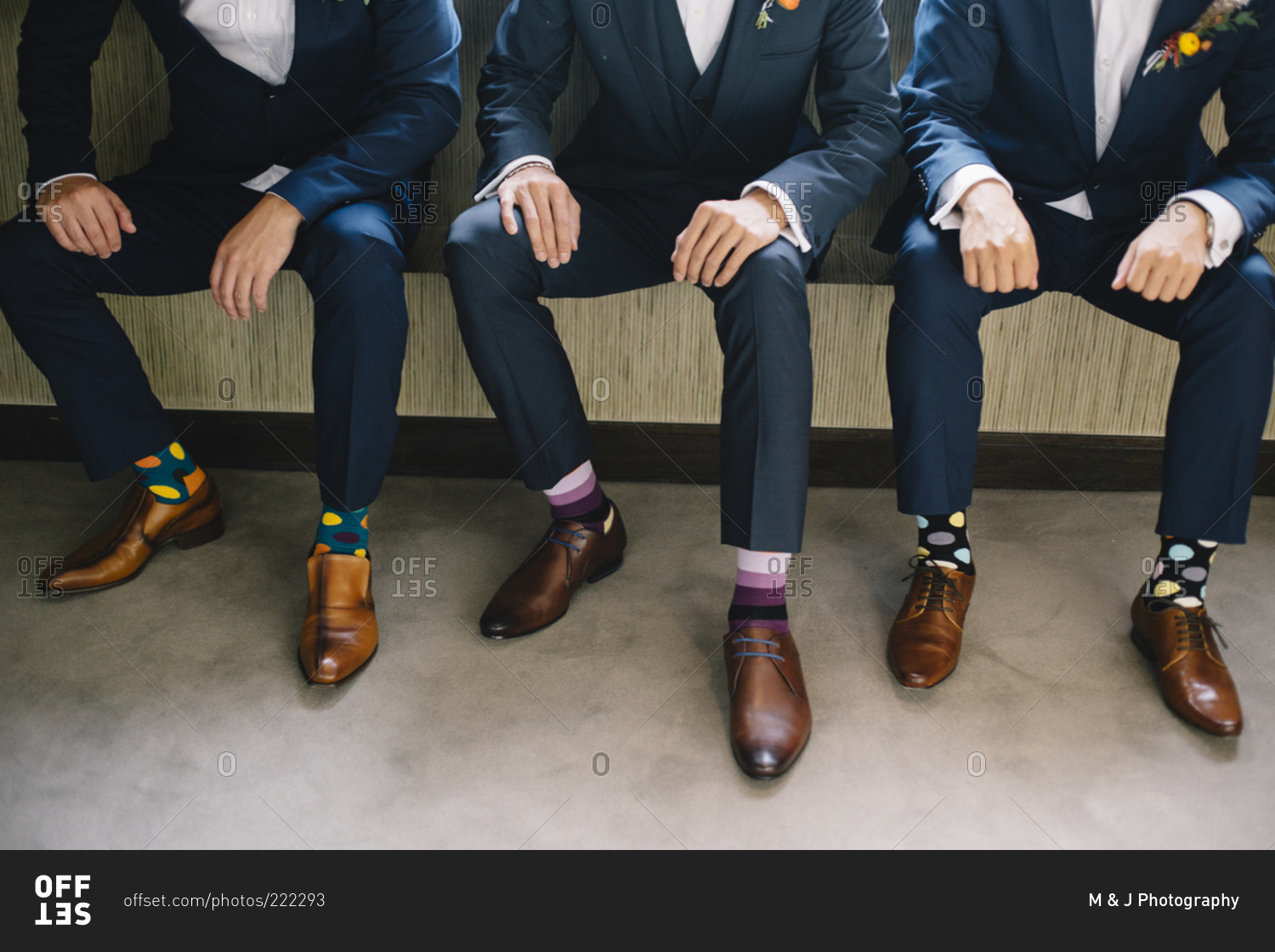 three groomsmen clad in brown shoes and multicolored