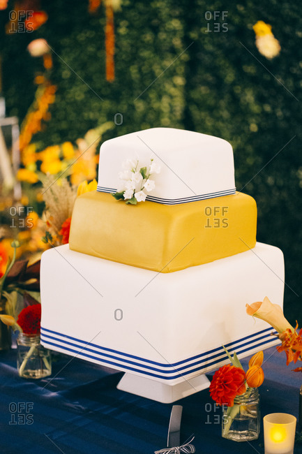 Yellow, white and blue three-tiered cake