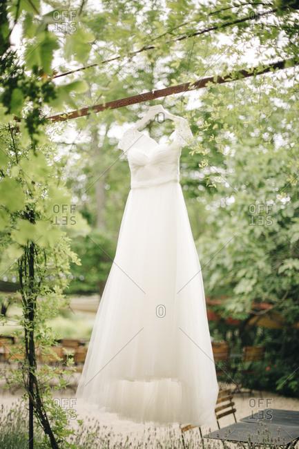 Wedding dress hanging in a garden