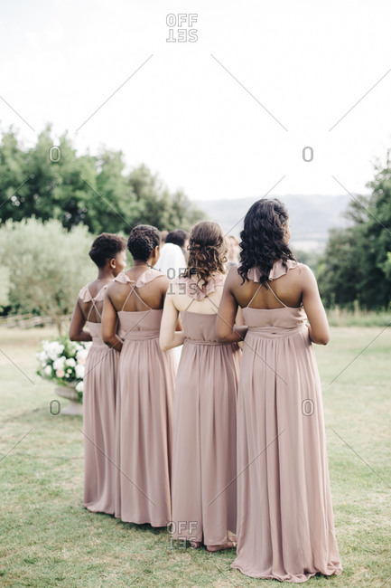 Bridesmaids standing side by side at a wedding