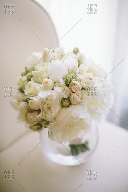 Flower bouquet of roses and peonies in a vase