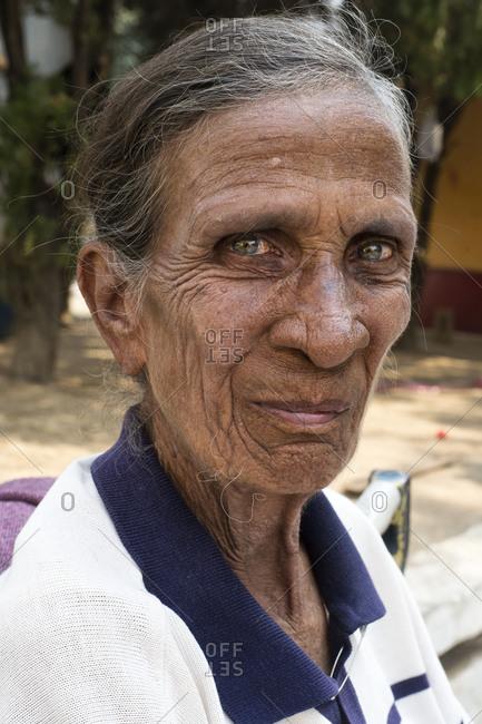 Yangon, Myanmar - March 2, 2015: Portrait of an elderly woman in Mandalay, Myanmar