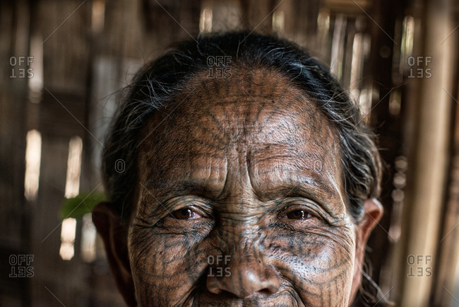 Mrauk U, Myanmar - March 11, 2015: Traditional face tattoos of a Kuki woman in Myanmar