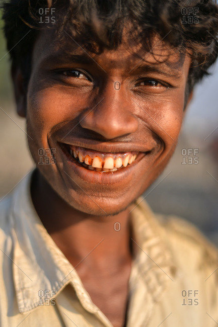Mrauk U, Myanmar - March 11, 2015: Portrait of a young Burmese man