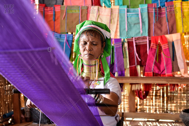 Inle Lake, Myanmar - March 3, 2015: Kayan woman weaving in Myanmar