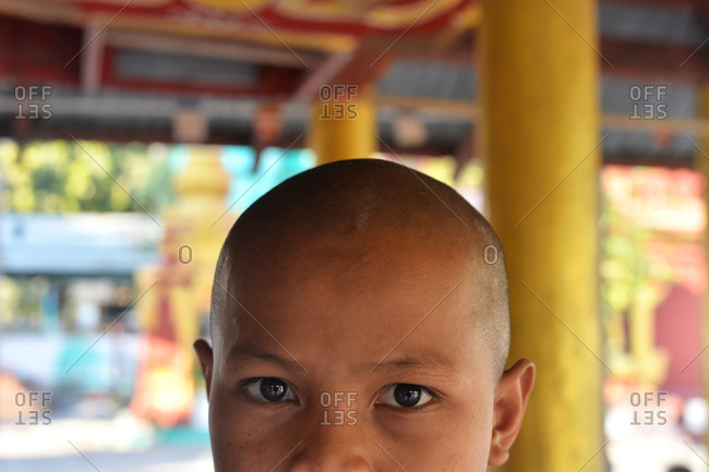 Amarapura, Mandalay, Myanmar - February 28, 2015: Close up of a novice monk in Myanmar