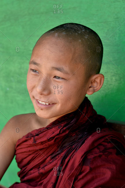 Mandalay, Myanmar - March 1, 2015: Portrait of a young Buddhist monk in Mandalay, Myanmar