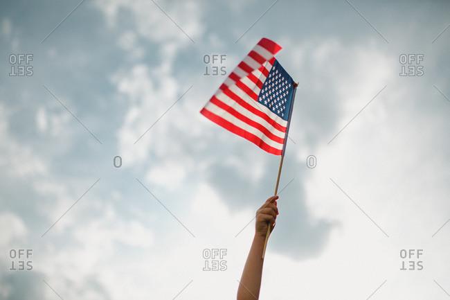 Child waving an American flag