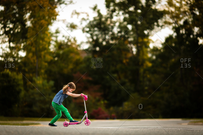 Girl riding a kick scooter