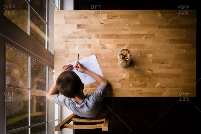 Boy drawing at a table