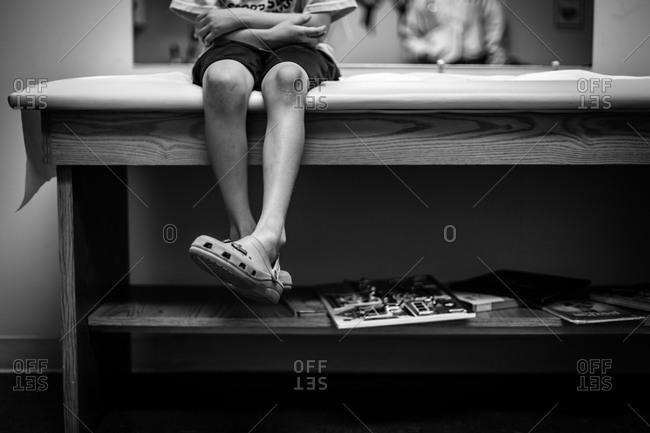 Boy waiting in a doctor's office