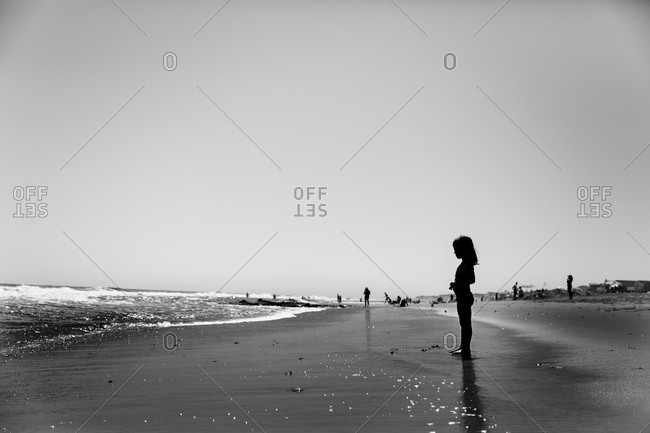 Silhouette of a girl standing on the beach