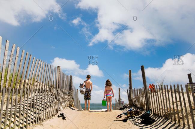 Children walking down to the beach