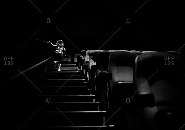 Girl walking up the stairs in a movie theater