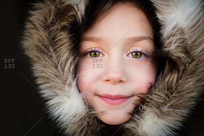 Portrait of girl wearing a furry hoodie