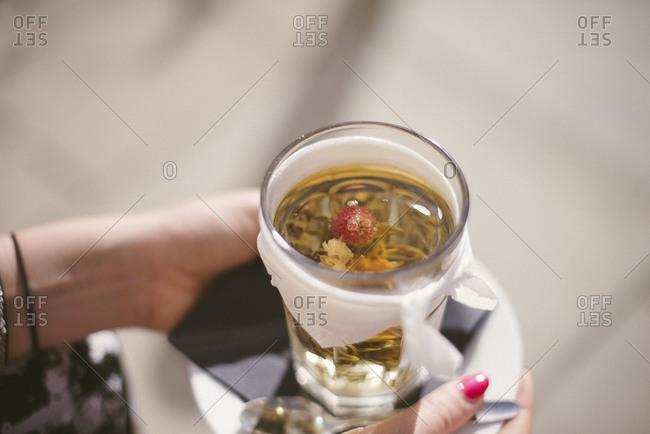 Woman holding an herbal tea