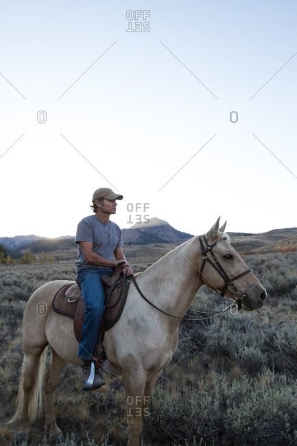 Man riding his horse in the countryside