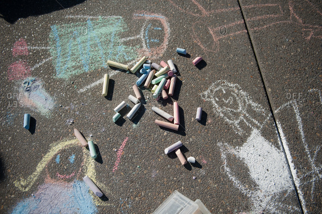 Chalk on pavement with drawings