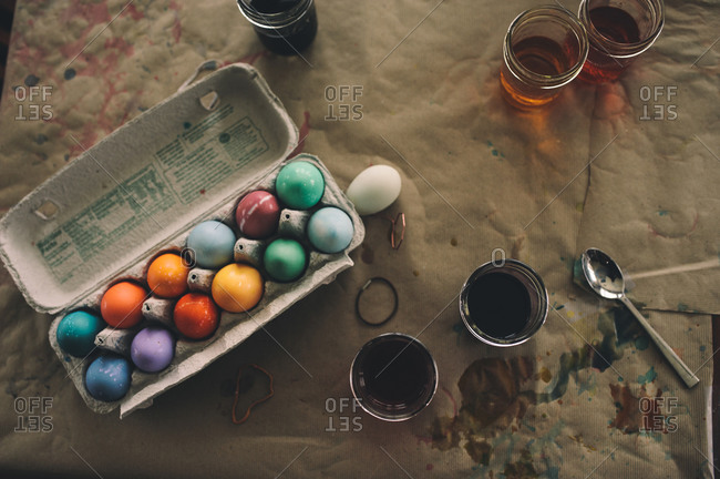 Carton of dyed eggs and jars of dye