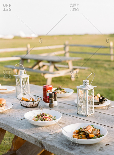 Outdoor supper arranged on a picnic table