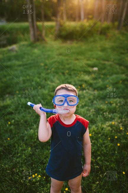 Young boy wearing a scuba mask
