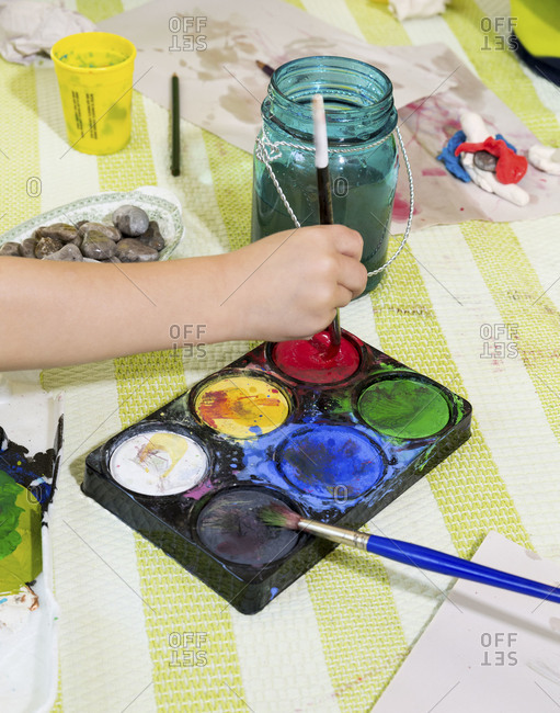 A child paining with watercolors