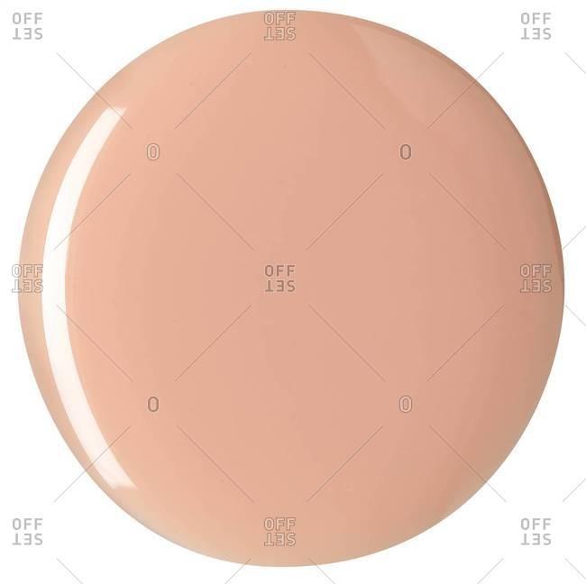 A circle of beige nail polish