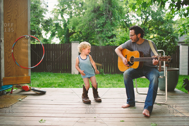 Little boy and Dad playing music