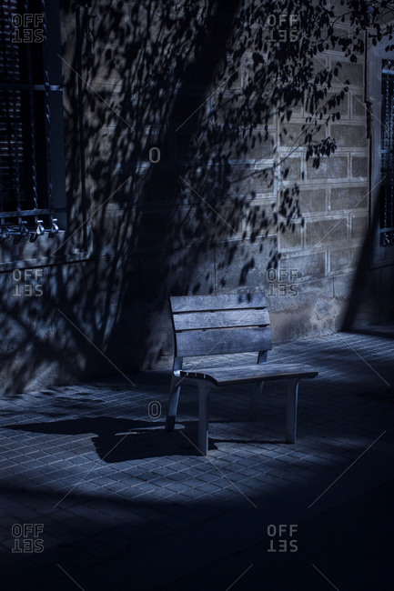 A park bench in the moonlight