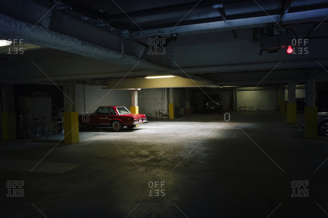 A parking garage with a few cars