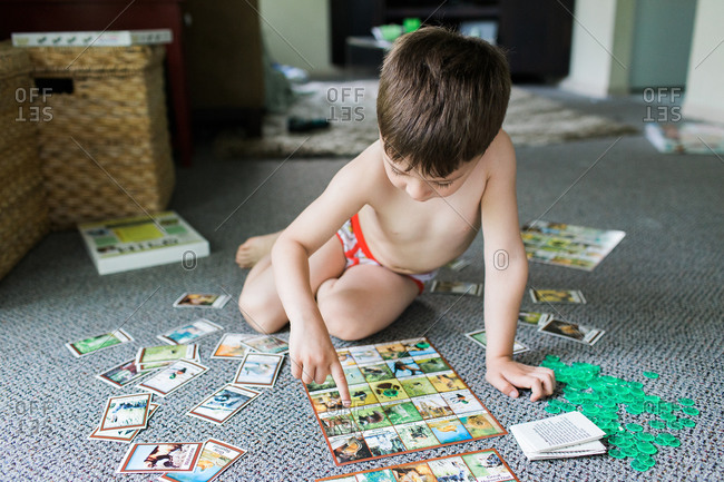 Boy on living room floor with memory game
