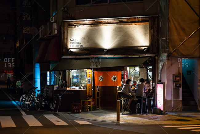 Motomachi, Osaka, Japan - May 4, 2015: Diners at corner restaurant outside