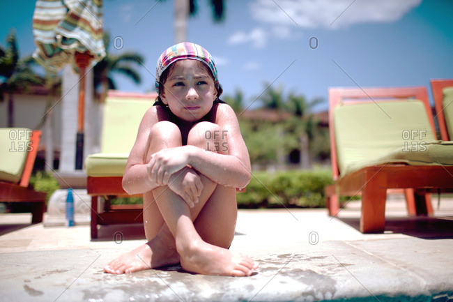 Young sitting on a poolside