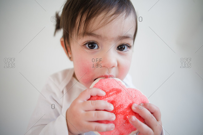 Young girl eating a snack