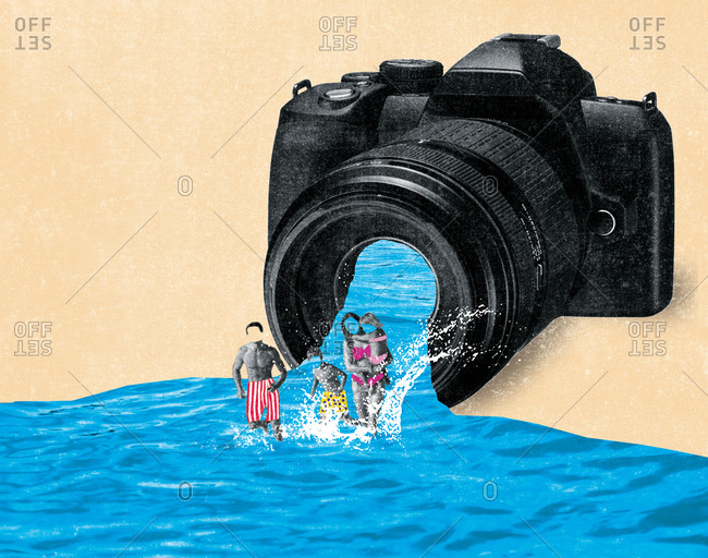Family bathing in the ocean in front of a camera