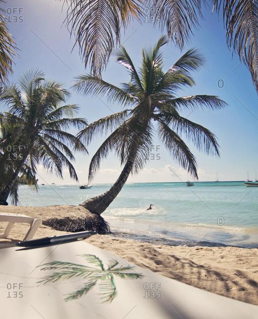 A drawing of a tropical beach sits on a tropical beach