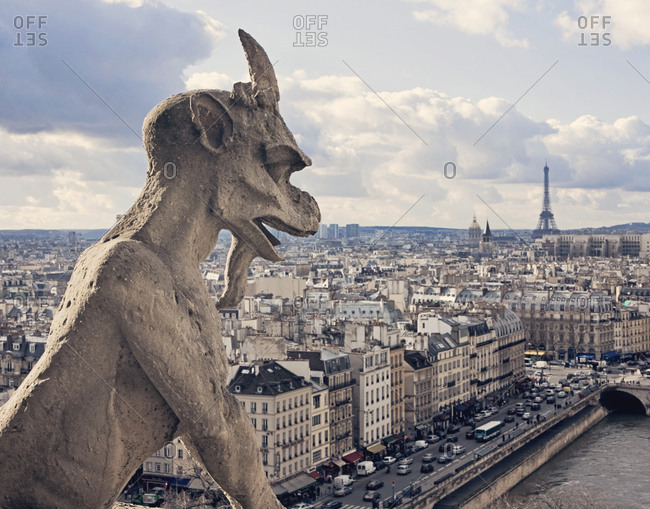 A gargoyle at Notre Dame cathedral stands guard over Paris