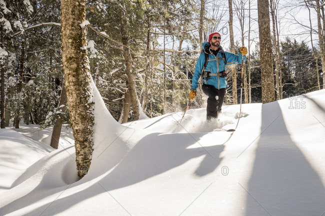 A cross country skier gets first tracks in fresh deep powder