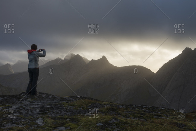 Female hiker taking picture from the summit of Markan