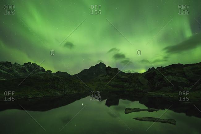 The aurora borealis fill sky mountains