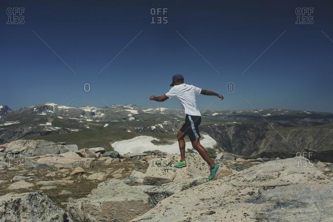 Man runs across boulders in Montana