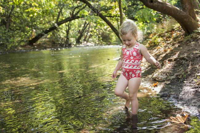 Toddler explores creek in Bidwell Park, Chico, California