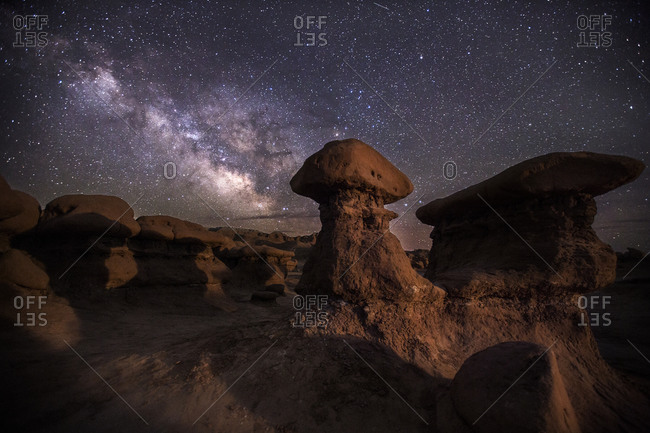 The Milky Way drifts across the night sky as the moon sets in Goblin Valley State Park